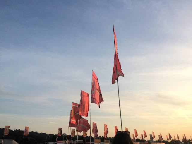 Blue skies and colourful flags