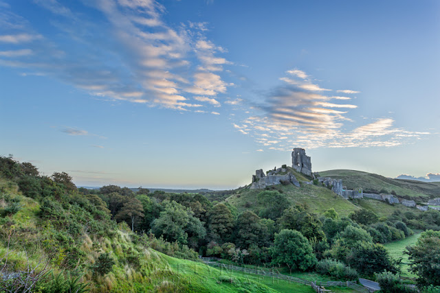 Dorset's atmospheric ruins of Corfe Castle in the crisp dawn light