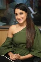 Pragya Jaiswal in a single Sleeves Off Shoulder Green Top Black Leggings promoting JJN Movie at Radio City 10.08.2017 007.JPG