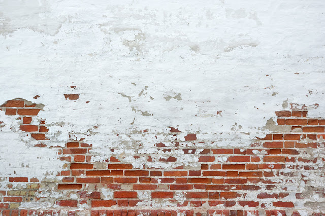 https://www.photowall.fi/sprinkled-white-plaster-on-red-brick-wall-tapetti