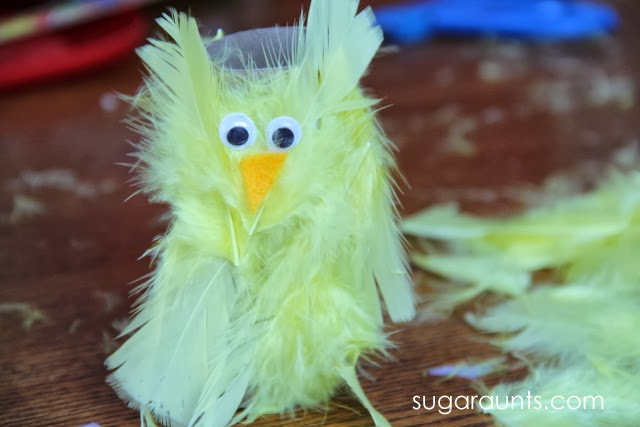 Create a peep juice box cover with feathers and a recycled paper tube.