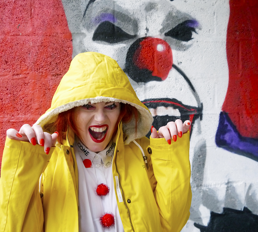 Yellow rain jacket and clown makeup for an easy look inspired by horror movie IT