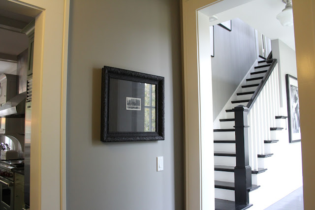 Modern farmhouse stairway with black painted wood floors on Hell Lovely Studio