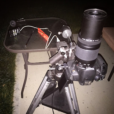 canon DSLR on motor tripod mount