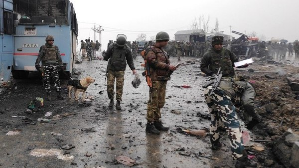 Image Attribute: Indian security forces inspect the remains of a vehicle following a bomb attack in Pulwama on February 14, 2019. / Source: Twitter