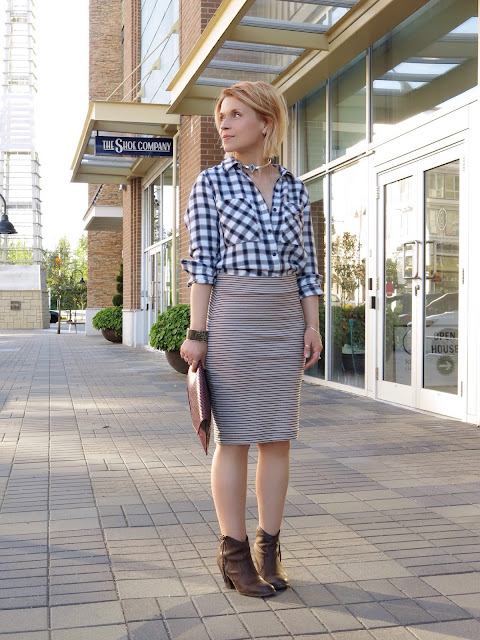 styling a plaid shirt with a striped pencil skirt and western-inspired booties