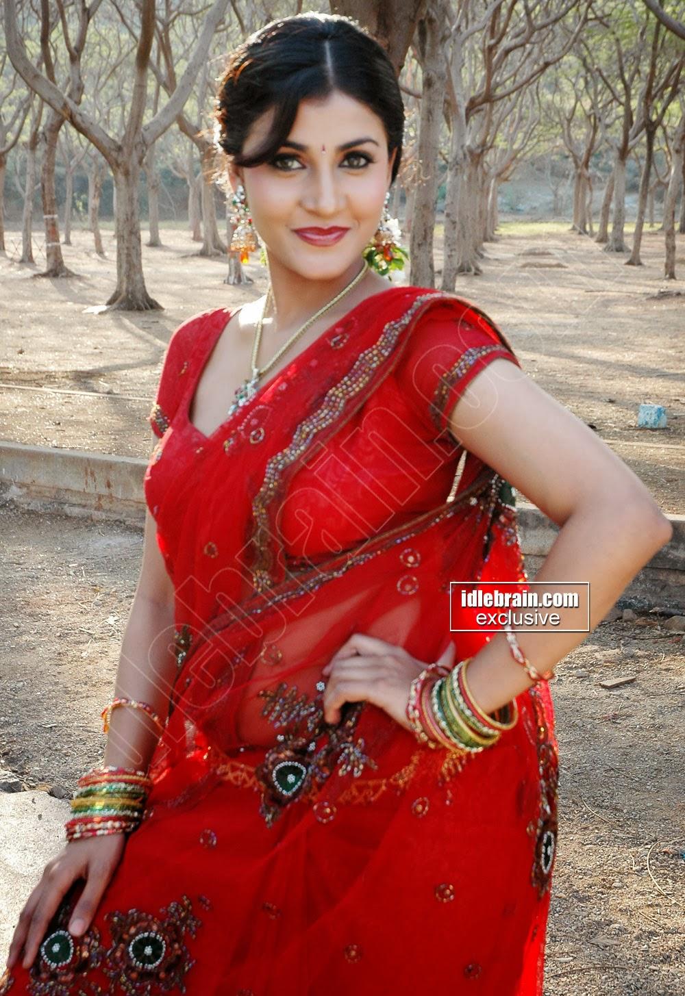 Kausha Rach Sizzling Stills In Red Saree-9645