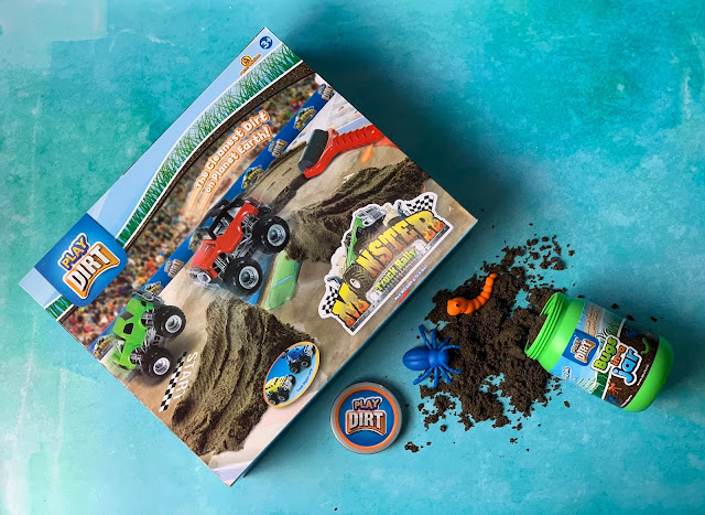 Play Dirt Monster Truck Rally box and an open box of Bugs In a Jar play dirt with the contents spilling out