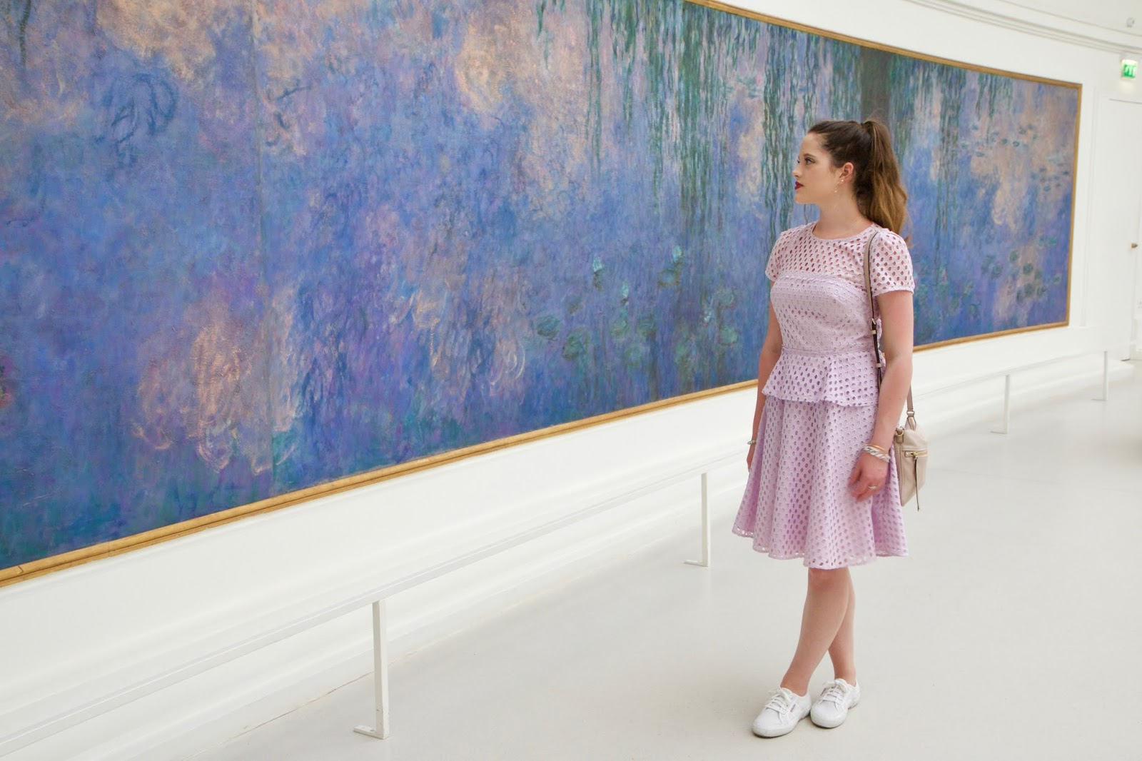 Fashion blogger Kathleen Harper looking at Monet's water lilies in Paris France