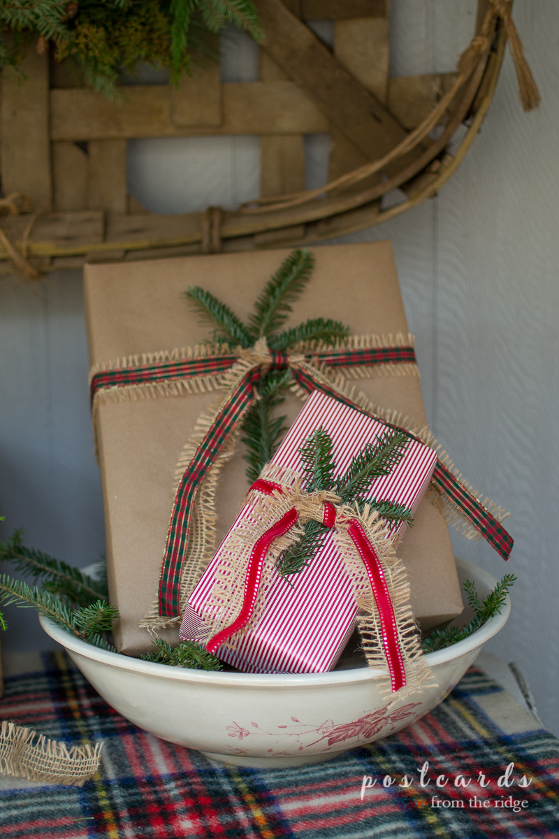 Wrapped packages are just one of many great Christmas porch decorating ideas on this site.