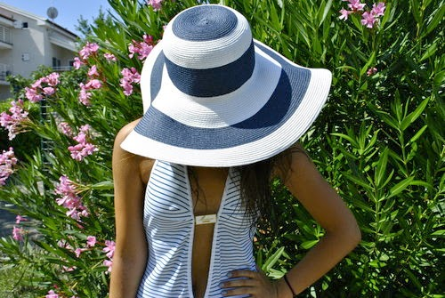 Wearing a Blue and White Striped One Piece Swimsuit with Striped Sun/Beach Hat