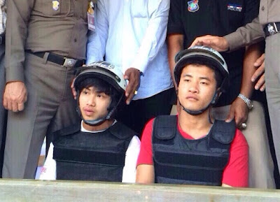 Wai Phyo, at left, and Zaw Lin are paraded in front of the media on Oct. 3, 2014, shortly after their arrest on Koh Tao.