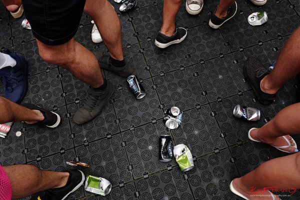 The shoes, the empty cans, the protective floor mating. Harbour Life Music Festival Sydney 2016. Photographed by Kent Johnson for Street Fashion Sydney.