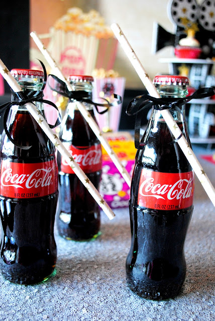 Add a little fun to your snack bar table with mini bottles of Coke. Inspiration can be found at www.fizzyparty.com