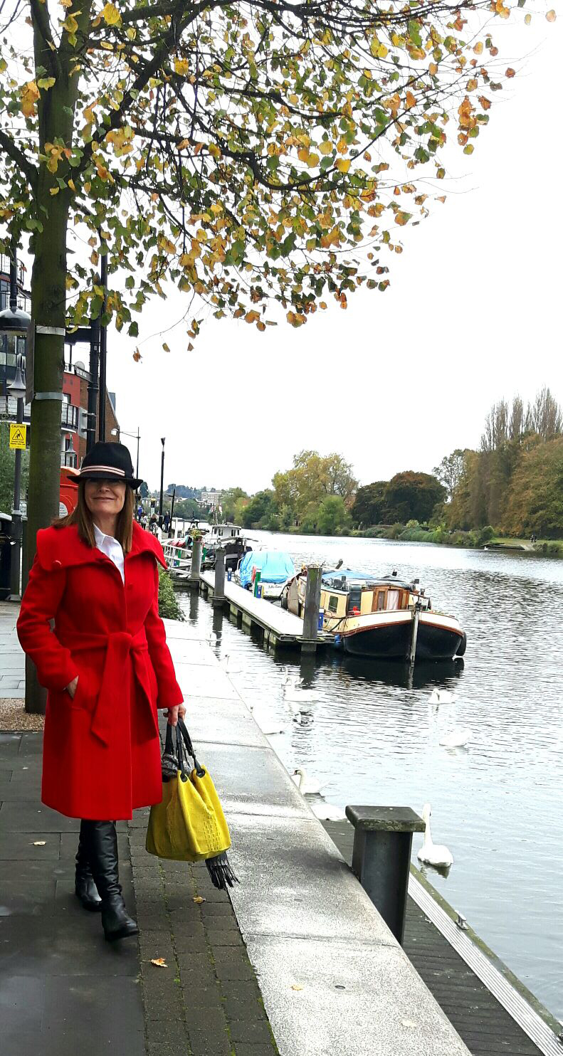 Image showing over 50 blogger Hilda Smith in black over the knee boots black hat and red coat