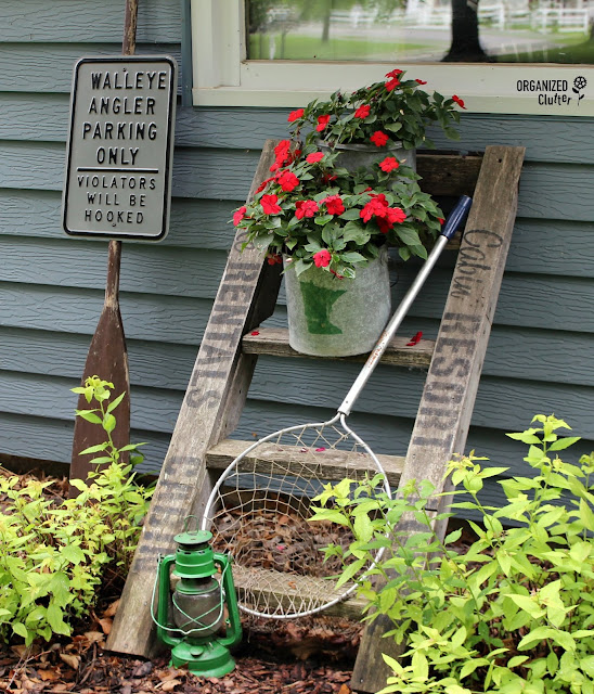 Cabin/Lake Themed Junk Garden Ladder Vignette