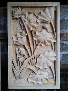 batu alam paras jogja atau batu paras putih relief bunga lotus