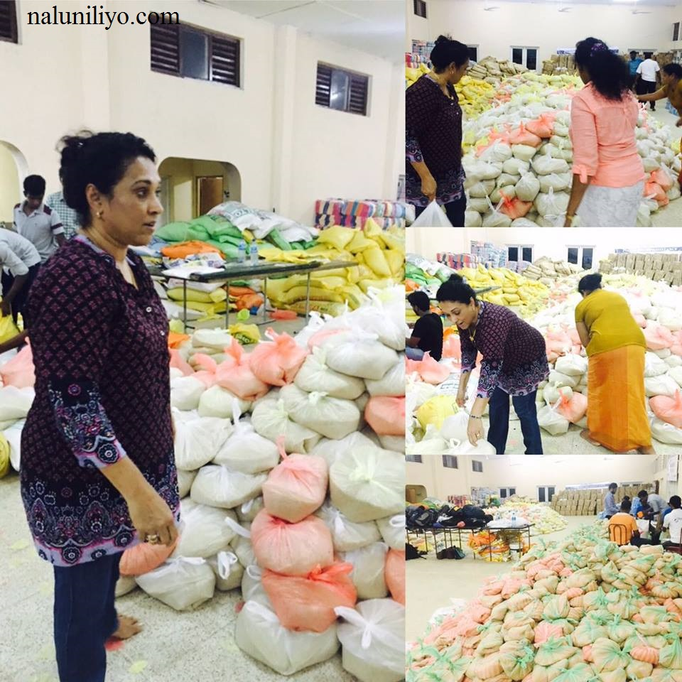 Janaki Wijerathne donating to flood affected people