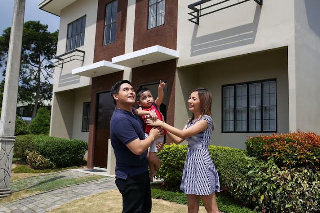 Happy family in front of their house from Lumina Homes