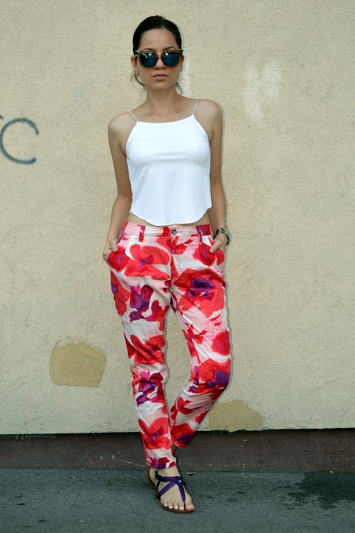 outfit, white crop top, blue mirrored cat eye sunglasses, floral pants, purple flip flops flat sandals, michael kors watch