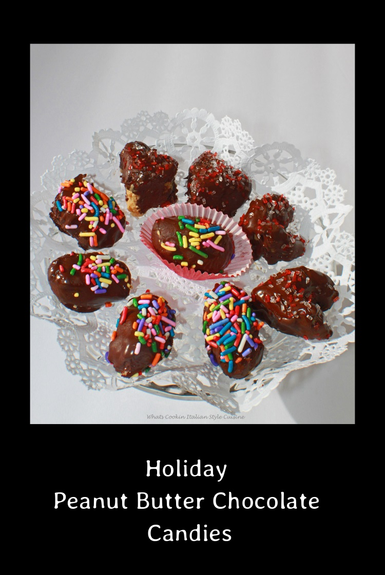 Holiday Peanut Butter Chocolate Candies made into the shapes of the holiday. Peanut filling shaped and dipped into decadent melted chocolate then sprinkled with colored sugar to match the holiday theme