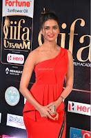 Meenakshi Dixit in Red One Shoulder Red Zipped up gown at IIFA Utsavam Award 08.JPG