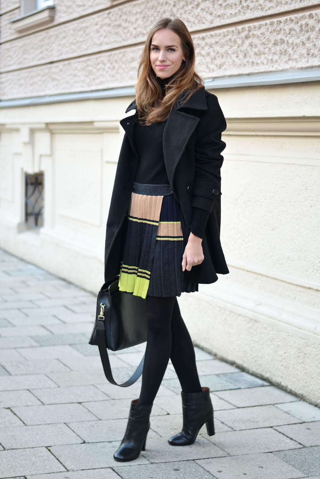 kristjaana mere pleated skirt peacoat heeled ankle boots winter outfit