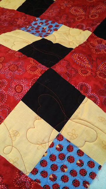 Quick and easy four patch baby quilt