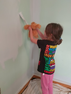 daughter painting walls