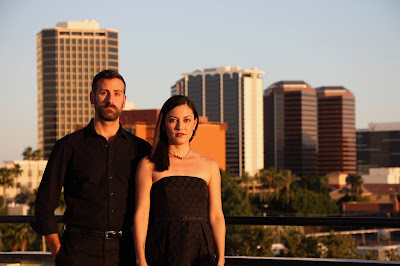 Image of Karen Sinclair and Christopher McKay standing in front of downtown Phoenix skyline