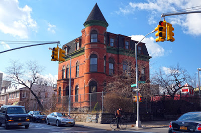 Red brick Mansion on street corner