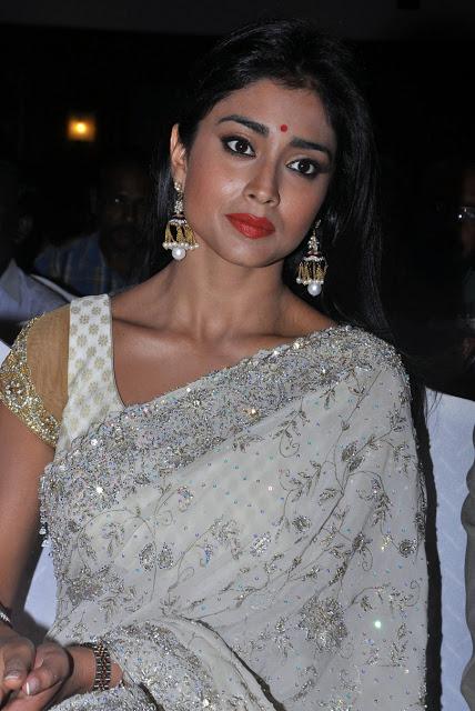 Gorgeous and stylish Tollywood actress shriya latest white designer saree stills