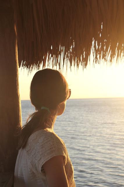 Sunset in Jamaica under a Tiki Hut