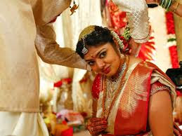 Meghana in her bridal outfit