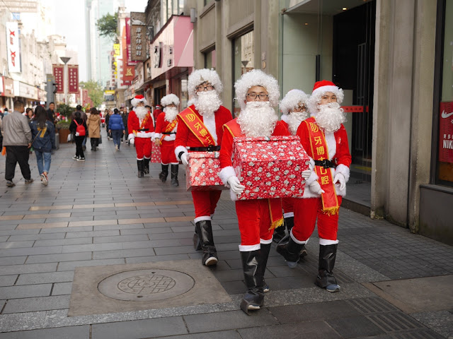 Santas walking down the Wuma Pedestrian Street in Wenzhou