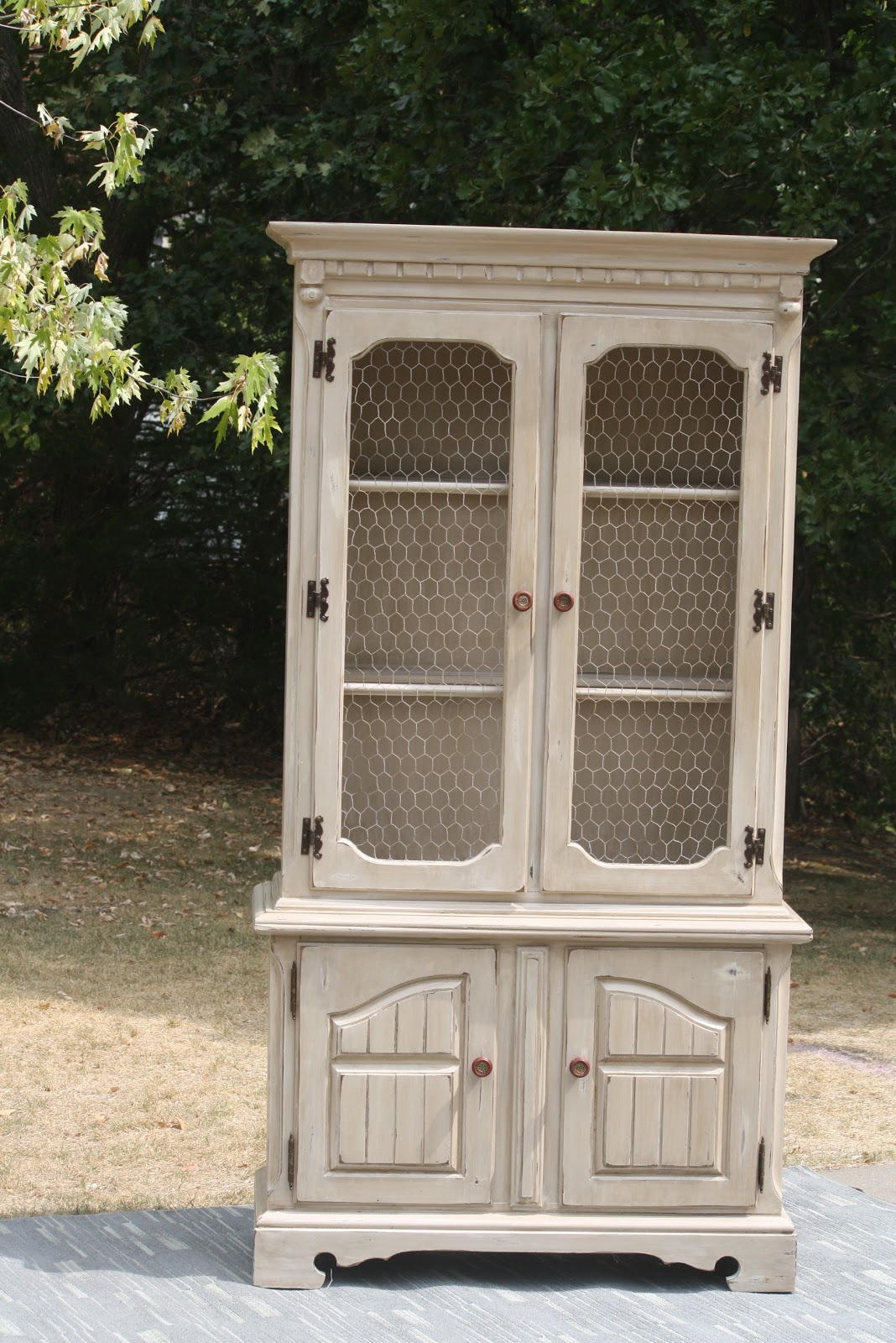 Never A Dull Day Creamy Distressed China Cabinet