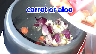 image of adding carrot and potato in cooker