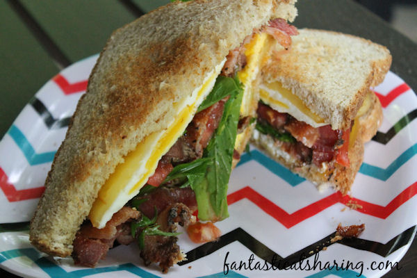 Heirloom BLT with Fried Eggs and Smoked Gouda // Amp up your BLT with a little fried egg, gouda cheese, and chipotle mayo #FantasticalFoodFight #recipe #sandwich #blt #bacon