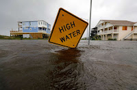 Flood waters lap at a high water warning sign that was partially pushed over by Hurricane Florence on Oak Island, North Carolina, U.S., September 15, 2018. (Credit: © Reuters/Jonathan Drake) Click to Enlarge.