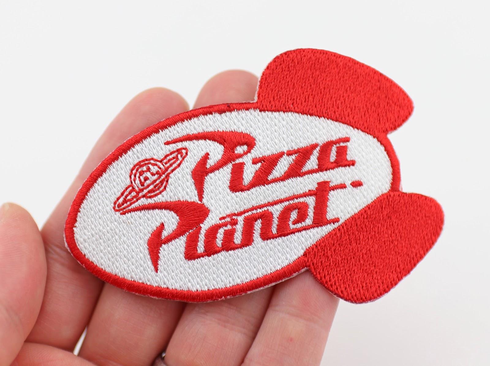 toy story pixar studios store pizza planet patch