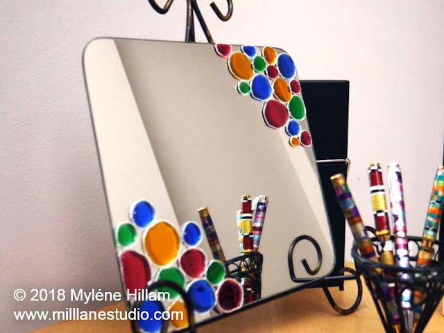 Resin jewelled mirror displayed with an assortment of Friendly Plastic mosaic pens