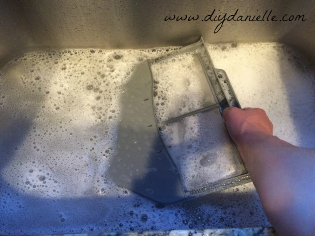 Wash the lint trap in hot soapy water.