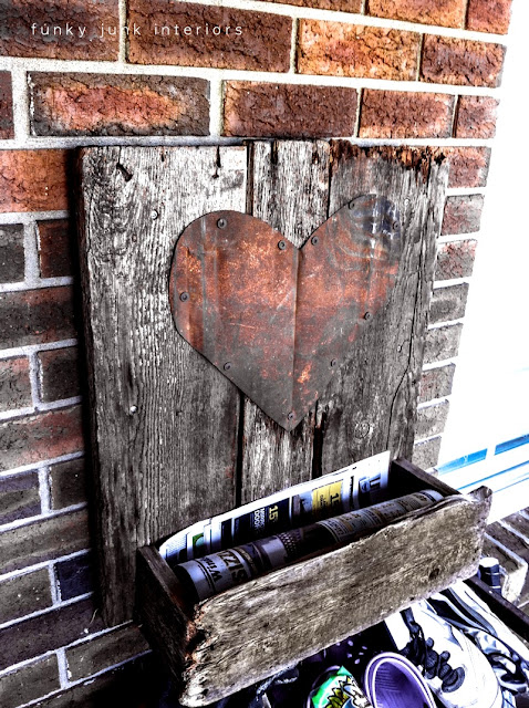 old wood mailbox with rusty heart