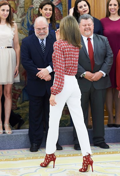 Queen Leti zia woreMassimo Dutti Trousers. Queen Letizia wore Mango Perforated Design Sandals, Carolina Herrera blouse