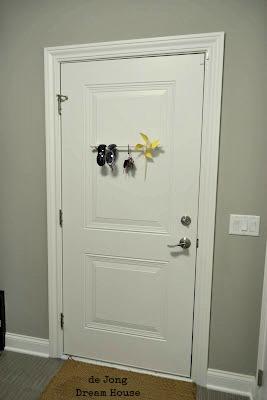 garage entry door to house, door from garage to house, door from garage into house, on door between garage and house
