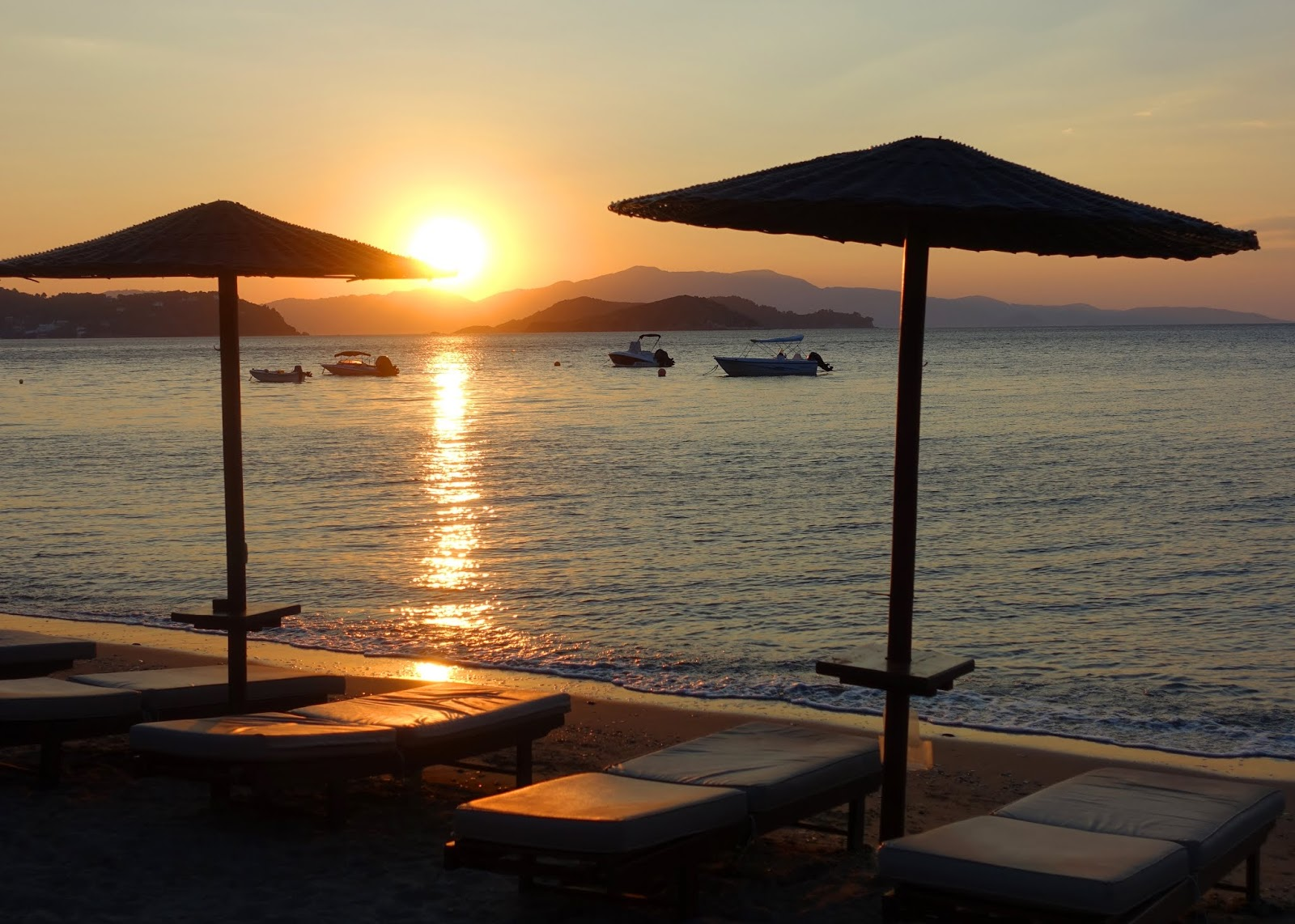 Sun rise over the sea and a beach at Skiathos, Greece