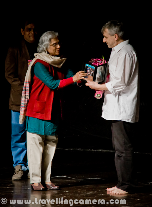 On second day of Bharat Rang Mahotsav, we choose to go for 'Grotowski - An Attempt to Retreat' which was presented by Chorea Theatre Association from Lodz, Poland. Let's have a quick Photo Journey of this play during second day of Bharangam 2012 (Kamani Auditorium)..This play started with a small talk by it's Director Tomasz Rodowics, who started telling about his interaction with Grotowski and influence of his questions in the play. Setup on the stage was sort of unique and I had never seen such setup in Indian Theatre, which doesn't mean that it was better but of-course different. Especially it was good for Photography, as background wrapped with transparent polythene sheet look amazing in final resultsAs per director of this play - 'This play as an experiment is both exciting and risky: 'Jerzy Grotowski – the greatest revolutionary of the 20th century, if we talk about theatre'. I am coming back to Grotowski after so many years partly as a result of my protest against what has been done to this person and partly because I feel I owe him something – as a human being, but most of all as an artist. Having seen his Apocalypsis cum figuris in 1974, I decided I have to do theatre – with no possibility of retreat. Today I feel I need to confront his practical achievements, his thoughts related to the theatre, man and religion. I do not want to achieve it through more recollections, conferences or seminars but through the practical experience of people who want to deal with theatre and need to know if they are somehow related to him or not. Is this a closed door or maybe there is a scratch, a mark, anxiety, taint and heritage to be confronted in order to see if you are worth it or if you should stand up to it areject it?Tomasz Rodowics started working on this project with people who, because of their age, had no contact with Grotowski, his para-theatrical and theatrical practice, the 'art as a vehicle' period, his actors or anyone who worked with him. What they knew abou