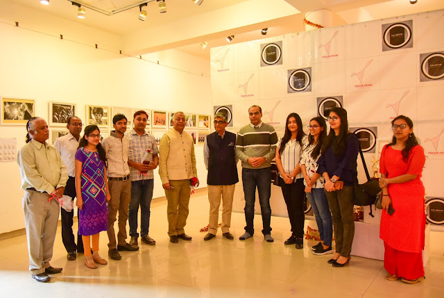 Group shot with photograph competition participant winners and co jury members.