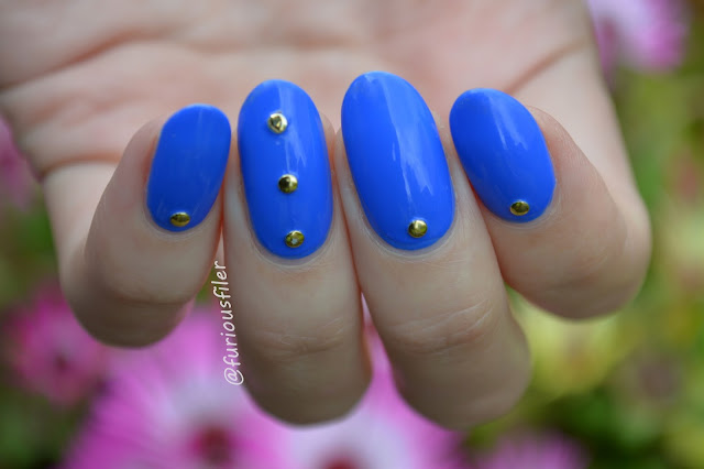 studded blue bright nails rimmel