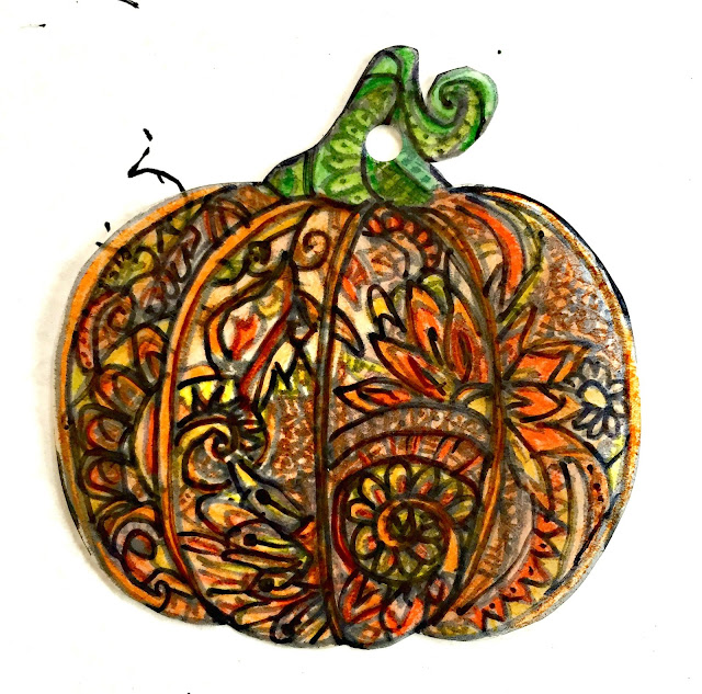 ShrinkyDink pumpkin before baking.